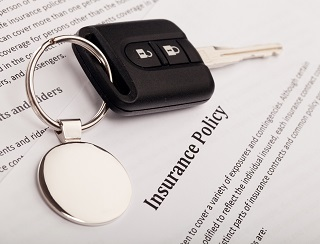 image of car keys and auto insurance policy
